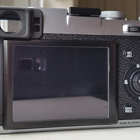 Silver Fuji X100s Boxed with a Few Extras