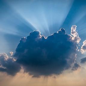 S120 Sun behind cloud